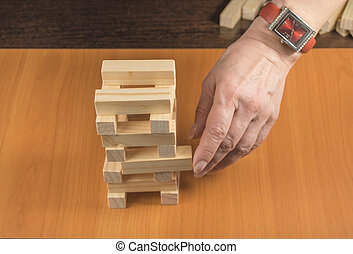 Planning, risk and strategy in business, tower, wooden blocks
