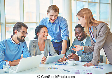 Planning work - Group of business partners discussing...