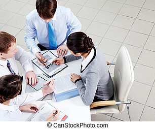Planning work - Image of confident employees discussing ...