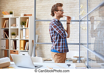 Planning work - Modern businessman reading reminders with...