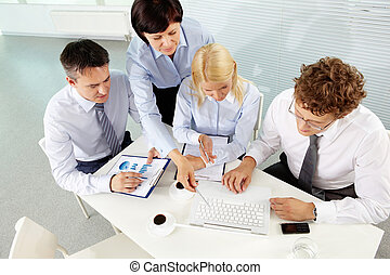 Planning work - Group of business partners planning work at...