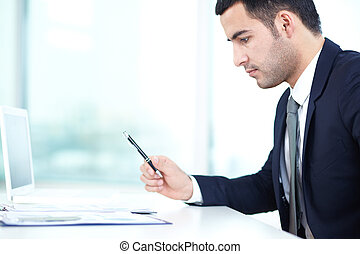 Planning work - Portrait of thoughtful businessman planning...