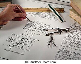 Plans - a man plans a design