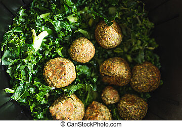 healthy plant-based food recipes concept, falafels and kale chips in air fryer