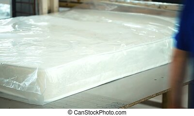 plant for making Ready mattress is packed in transparent...