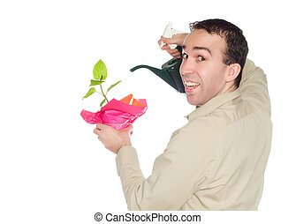 Plant Growth - A smiling young man is encouraging plant...