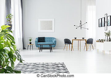 Plant in open space interior - Plant and patterned carpet in...