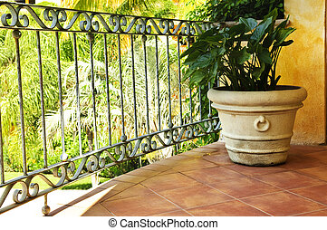 Plant on tiled Mexican veranda - Tiled Mexican balcony with...