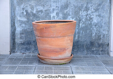 Plant pot with house wall in loft style.