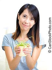 planta, mulher, potted, segurando, asiático