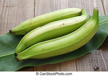 plantain banana on wooden background