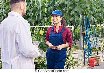 Plantation Worker talking to Scientist
