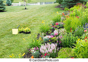 Planting new flowers in a spring garden
