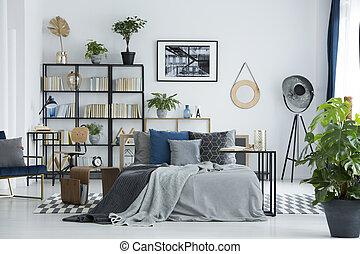 Plants in multifunctional bedroom interior