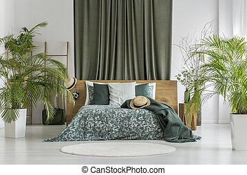 Plants in olive bedroom