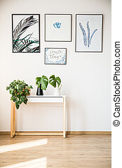 Plants on small table - Plants standing on small table under...