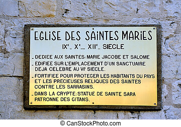 plaque explaining the history of the church of...