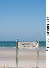 Plaques with text Sea and blue sky in the background.