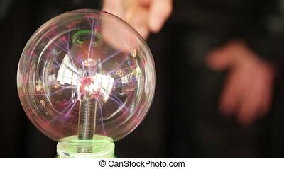 Plasma ball - Touching a plasma ball at the children's...