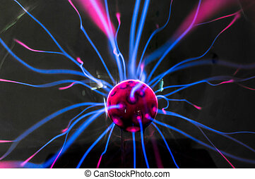 Plasma ball with magenta-blue flames isolated on a black ...