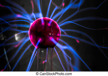 Plasma ball with magenta-blue flames isolated on a black...