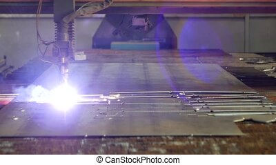 Plasma cutting of metal on a modern laser machine, close-up, production of plasma metal cutting, automated