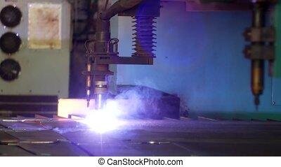 Plasma cutting of metal on a modern laser machine, close-up,...