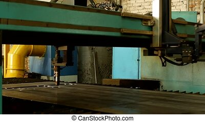 Plasma cutting of metal on an automatic laser machine, laser plasma cutting machine for cutting parts from metal, production, technology
