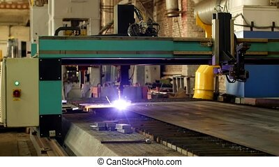 Plasma cutting of metal on an automatic laser machine, laser plasma cutting machine for cutting parts from metal, production, metal