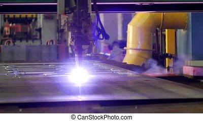 Plasma cutting of metal on an automatic laser machine, laser plasma cutting machine for cutting parts from metal, production, industrial