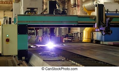 Plasma cutting of metal on an automatic laser machine, laser plasma cutting machine for cutting parts from metal, production, mechanical