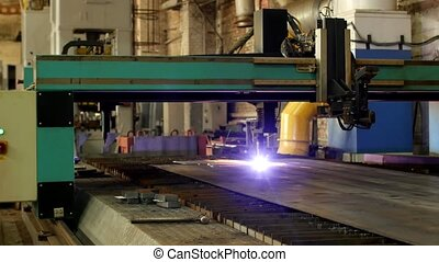 Plasma cutting of metal on an automatic laser machine, laser plasma cutting machine for cutting parts from metal, production, equipment