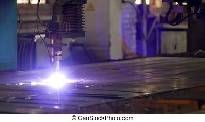 Plasma cutting of metal on an automatic laser machine, laser plasma cutting machine for cutting parts from metal, production