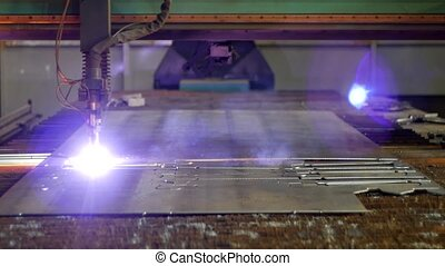 Plasma cutting of metal on an automatic laser machine, laser...