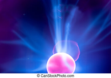 Plasma electric ball lightning lamp. Fascinating space video, close-up of electrical discharges with blue flames on a dark background