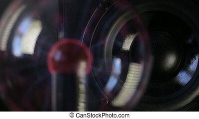 Plasma globe reacting on speaker playing