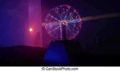 Beautiful plasma ball in the dark room make nice neon lights.