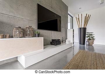 plasma television, på, betongvägg