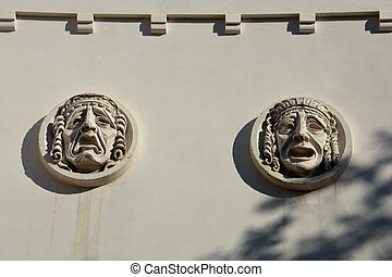 Plaster masks on wall of the theater