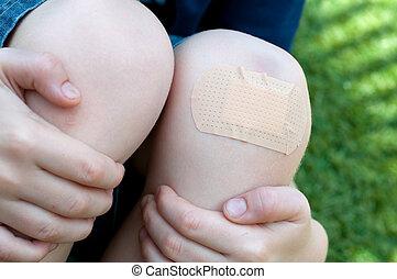 Plaster on knee