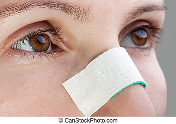 Plaster on wound nose