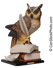 plaster statuette of an owl isolated on white background. ...