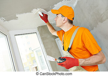 Plasterer at indoor ceiling work - Plasterer at indoor...