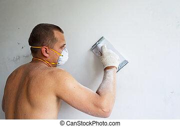 Plasterer at indoor renovation