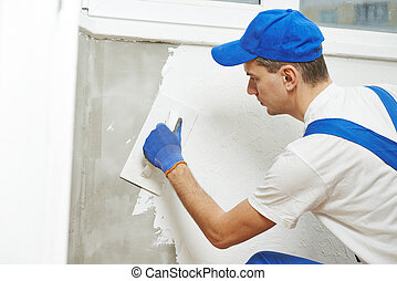 Plasterer at indoor wall work - Plasterer at indoor wall...