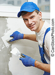 Plasterer at indoor wall work - Plasterer at indoor wall...