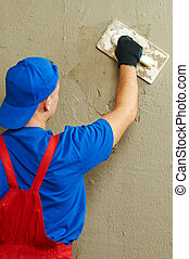 Plasterer at work - Plasterer at indoor wall renovation ...