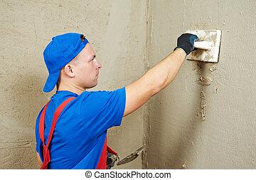 Plasterer at work - Plasterer at indoor wall renovation ...