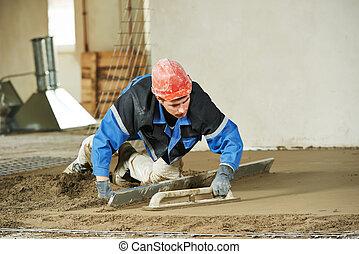 Plasterer concrete worker at floor work - Plasterer at ...