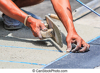 plasterer concrete worker smooth the cement with trowel